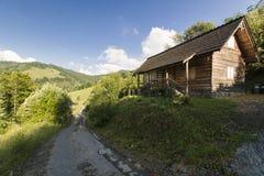 Hus i berg Royaltyfri Foto