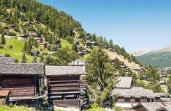 Hus i berg Fotografering för Bildbyråer