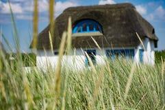 Hus i dyerna Fotografering för Bildbyråer