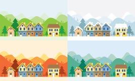 Hus i fyra säsonger med bergbakgrund Royaltyfri Fotografi