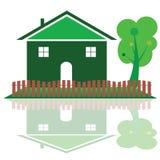 Hus i grön färg med trädillustrationen Royaltyfria Bilder