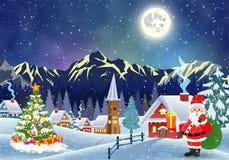 Hus i snöig jullandskap på natten Arkivfoto