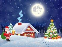 Hus i snöig jullandskap på natten Royaltyfri Foto