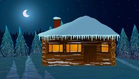 Hus i snön på natten Royaltyfri Fotografi