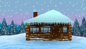 Hus i snowen Arkivfoton