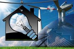 Hus - ljus kula - solpanel - vindturbiner Royaltyfria Bilder