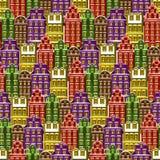 hus mönsan seamless Liten stadbakgrund för tegelplatta Textur för inpackningspapper med flerfärgade byggnader Illustrerad vektor Arkivfoton