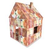 Hus med 10 euroräkningar Royaltyfri Bild