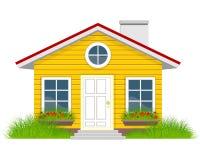 Hus med grassplot Fotografering för Bildbyråer