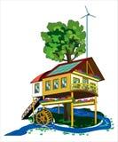 Hus med källor för alternativ energi Arkivbilder