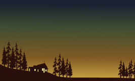 Hus med ljus i fält Arkivfoto