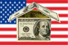 Hus med pengar royaltyfri bild
