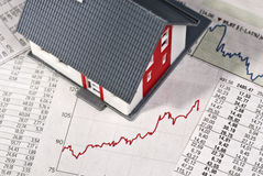 Hus med tabeller och grafen Arkivbilder