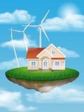 Hus med vindturbiner på en sväva ö Arkivbild