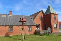 Hus och miniatyrmodell av en kyrka, Danmark, Europa Royaltyfria Foton