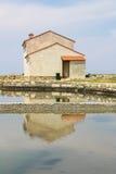 Hus på ett salinalandskap arkivbild