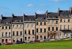 Hus som förbiser en parkera Royaltyfria Foton