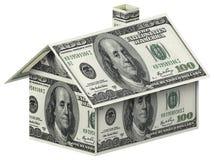 Hus som göras av 100 dollarräkningar Arkivbilder