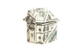 Hus som göras av 100 dollarsedlar Arkivbild