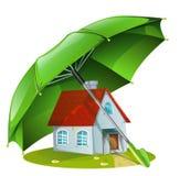 Hus under ett grönt paraply Arkivbild