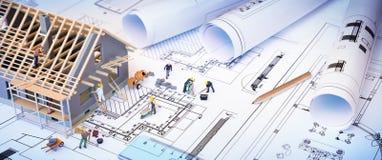 Hus under konstruktion på ritningar Royaltyfria Foton