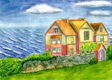 Hus vid havet Arkivbild