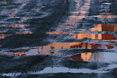 Husavik church reflection at sunset. Husavik church reflected in puddle at sunset. Shot in Iceland, early spring Royalty Free Stock Photo