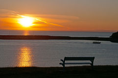 Husavik, Iceland, Northern Europe, bench, relax, sunset, sun. A bench at sunset in Husavik on August 25, 2012. Husavik is a fishing town on the north coast: it Royalty Free Stock Photography