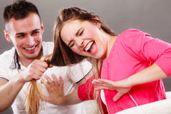 Husband abusing wife pulling her hair. Violence. Stock Photography
