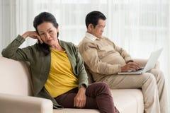 Husband addicted to internet Royalty Free Stock Photos
