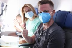Free Husband And Wife Are Flying On Plane Wearing Medical Masks Stock Photo - 196352690
