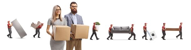 Free Husband And Wife Holding Cardboard Boxes And Movers Carrying Household Items Behind Stock Images - 186440914