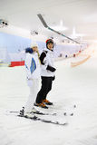 Husband And Wife Standing On Skis Royalty Free Stock Images