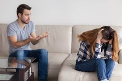 Husband annoy talking to tired of fighting wife. Desperate wife tired of arguing and fighting with husband sitting upset on couch, angry men talking to upset stock images
