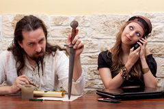 Husband is annoyed by telephoning render woman Stock Photos