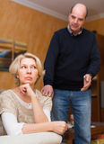 Husband asking wife for forgiveness. Guilty senior husband asking wife for forgiveness stock photography
