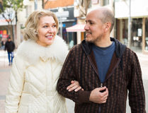 Husband and blonde wife having a walk Royalty Free Stock Photography
