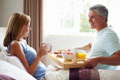 Husband Bringing Wife Breakfast In Bed On Tray Royalty Free Stock Images