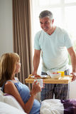 Husband Bringing Wife Breakfast In Bed On Tray Stock Photography