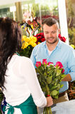 Husband buying roses bouquet romantic flower market Stock Photo