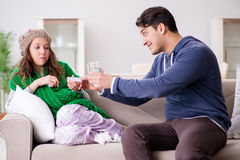 The husband caring for sick wife Stock Image