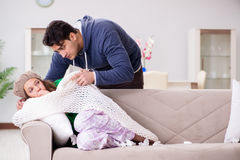 The husband caring for sick wife Royalty Free Stock Photography
