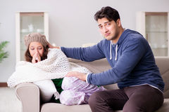 The husband caring for sick wife Stock Images