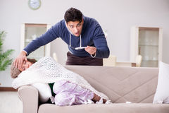 The husband caring for sick wife Royalty Free Stock Image