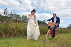 Husband chases after his wife on their wedding Day Royalty Free Stock Photo