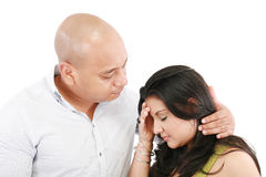 Husband comforts his wife Stock Images