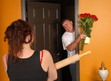 Husband coming home late to angry wife Stock Image