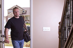 Husband Coming Home from Work. Opening the Door stock photos