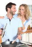 Husband cooking Royalty Free Stock Image