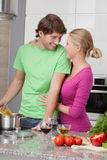 Husband cooking dinner Royalty Free Stock Photos